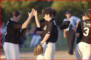 Dodgers Millie Edwards (left) and Jane McLucas celebrate after cruising to victory.