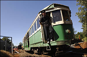 Tram driver Ian Phemister of Coffs Harbour, with the one tram currently operating at the Glenreagh Mountain Railway.