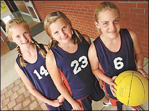 Bishop Druitt College State basketball representatives, from left, Alex Galbraith, Lauren Smith and Adrienne Oates.