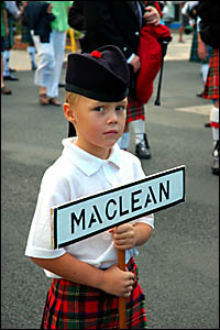 Leading the Maclean and District Pipe Band at last year?s Highland Gathering parade is Callum Clark.