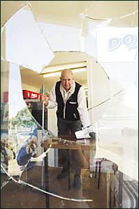TREVOR Jones in his damaged shop.