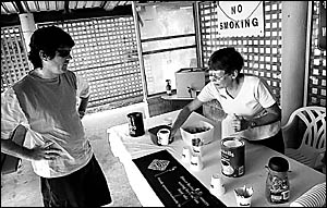 Stop, revive, survive . . . Jan Hawke gives Ben Connors a cuppa at Woolgoolga yesterday.