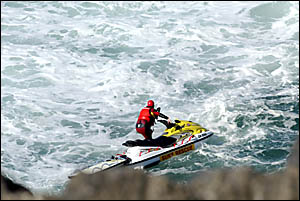 Lifesaver knocked from his jet ski search