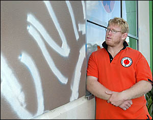 GRANT Ratcliffe is disgusted by the tagging of his business by vandals. Photo: TOM WYNESS
