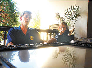 Harvey Norman Coffs Harbour Suns men?s State League team coach Peter Barton relaxes at home with his daughter.