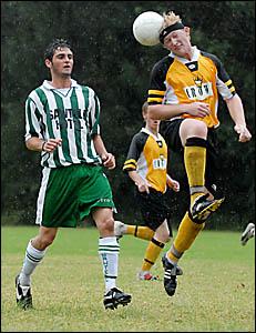 Matthew Cheeney leaps high above Sawtell?s Rory Goddard