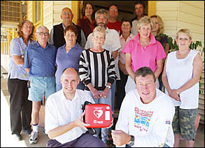 LIFESAVER:Dieter Meszaros presents president of the fundraising committee Tony Mortimer with the defibrillator.