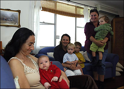 MOTHERLY LOVE: Karina Dunn with Asha, 10 weeks, left, Deanne Langford with Levi, 15 months, and Nash, 3, and Louise Kirby with