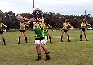BEAUTIES and the Beast ... The Tweed Coast raiders raiderettes are joined by Captain raider.