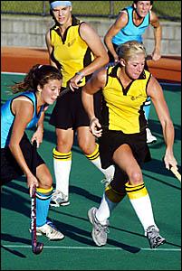 Casuarina?s Sharon Buchanan (left) closes in on Labrador rival Kylie McEniery during their JH Williams Hockey League encounter