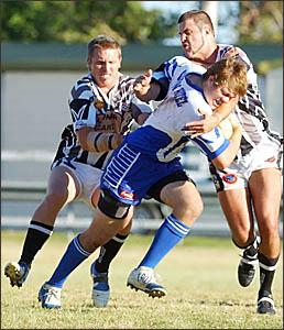 Magpies Dan Cowling and Aaron Murray drag down a Ghost attacker. Photo: DEBRAHNOVAK.