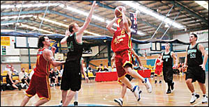 Coffs Harbour Suns men?s State League player Dirk Miller drives towards the basket against Hornsby Spiders.