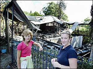 PAM Smith and Jo O?Connell, survey the burnt remains of what was only a few hours before the house that  adjoined their propert