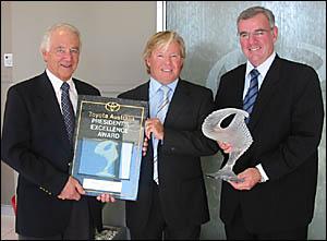 Tony Stark (centre), dealer principal of Hinterland Toyota at Nerang and Burleigh Heads, recieves the prestigious award.