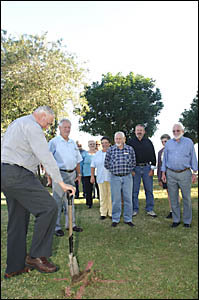 Clarence Valley Council mayor Ian Tiley turns the first sod for the new Vietnam veterans memorial to be built at Memor