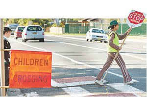 Serious business: crossing supervisor Julie Dunn marching out to face the traffic and help our school children to safety.