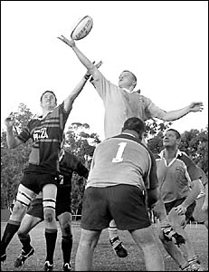 Coffs Harbour?s Connor Barrett, left, steals the line-out ball from Old Bar?s Todd Kennewell.