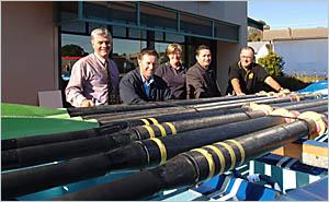 TO THE RESCUE: Minnie Water-Wooli Surf Life Saving Club committee member Paul Vaessen, left, president Peter Grainger, Gail Ben