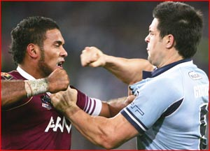 Justin Hodges and Eric Grothe exchange blows during the first State-of-Origin. Image: Chris McGrath ? GETTY IMAGES