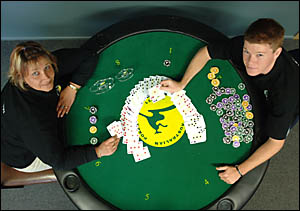 I?LL RAISE YOU:Poker proponents Ariane Fudge, left, and Aaron Marr show their poker prowess.