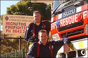 Grafton Fire Brigade captain Greg McLennan, back, and station officer Matt Malone call for new recruits.