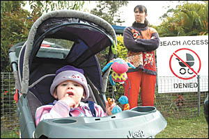 Arrawarra resident Kathryn Kenewell can?t wheel 16-month-old Helen to the beach in her pusher, not only because  the access has