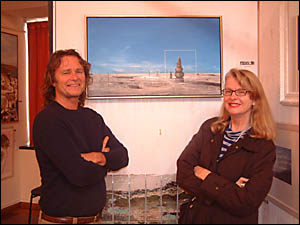 Artist Ken Johnson and FEHVA organiser Dee Tipping admire one of Ken?s paintings which will be auctioned at the FEHVA art aucti