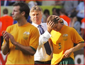 Socceroos coach Guus Hiddink consoles Jason Culina after the loss to Italy. Image: AAP IMAGE