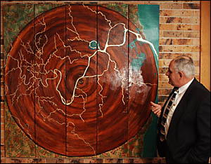 Clarence Mayor Ian Tiley casts his eye over artwork depicting th Clarence Valley?s heritage in red cedar.
