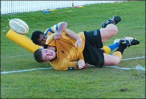 A Yamba Buccaneers player crashes over for a try against Southern Cross University on Saturday. The Buccs won the game 44-17.