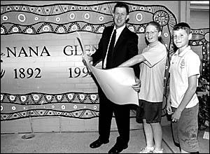 Federal MP Luke Hartsuyker shows Nana Glen Public School captains Rachel Waterhouse and