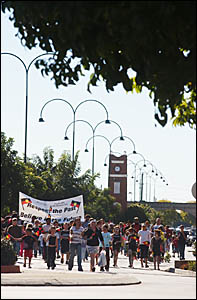 WALK ON: More than 200 people walk along Prince Street, Grafton, as part of NAIDOC Week celebra tions.