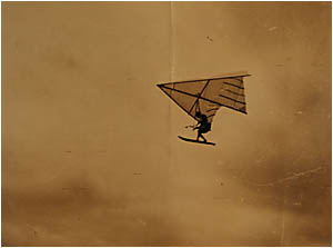 UP, UP AND AWAY: Rod Fuller soars above the Clarence River. In 1963 he became the first person to use a flexible-wing hang-glid