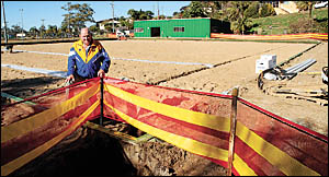 Nambucca Heads Bowling Club Ltd chairman, John Hunt fronts the old grass greens which have been excavated to provide new synthe