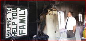 Gatton CIB Detective Senior Constable Dave Neumann investigates the scene of the arson attack. Image:BEV LACEY