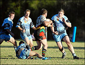 Clash of the titans  . . . Sawtell?s man of the hour Neal McCarthy confronts Xavier Sullivan.
