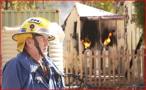 Millmerran fire chief John Purcell at the scene of the region's latest house fire yesterday. Image: NEVILLE MADSEN
