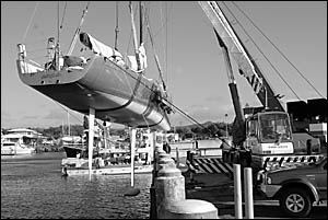 Appearing like a fish out of water, the stricken Wild Oats X is hauled above the Coffs Harbour international marina yesterday m