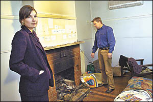 Melissa and Shane Eichmann inspect the damage caused by tenants at their Coffs Harbour property.