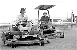Racecourse manager Drew Cookson (left) and Glenn Gallatly don?t want any more rain as they prepare the track for Coffs Harbour?