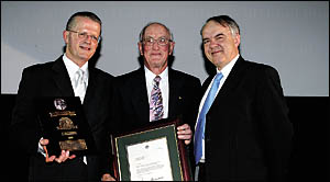 Legend inductee Al Ramsay, centre, with the CEO of Basketball Australia, Scott Derwin, left, and the Federal Minister for Sport