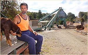 Daniel Lombo with the sawmill?s kelpie.