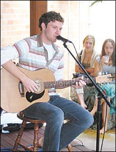 Musician Jack Carty entertains some Bellingen fans.