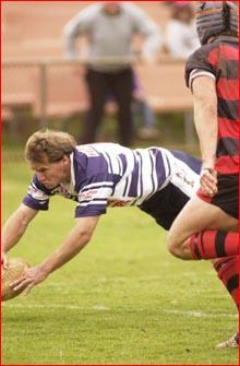 Valleys' Justin McKellar is wrapped up by Gatton centre Cliff Brown. Pic: Scott Fletcher