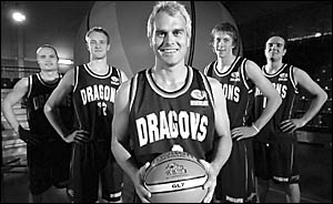 Shane Heal, centre, poses for a photograph at the launch of the new National Basketball League (NBL) team the Southern Dragons