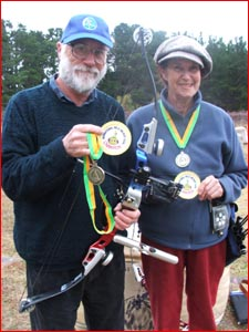 Darling Downs Field Archery Club members Tony and Valerie Smith with the medals they won at the world titles. Image: Supplied