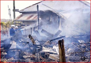 A Mt Tyson family lost everything they owned  when a fire burnt their house to the ground yesterday. Image: Nev Madsen