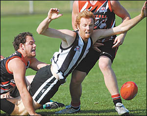 Sawtell?s Luke Matthews, left, tackles Port?s Jon Stephens in Saturday?s AFL North Coast Preliminary Final played at the Coffs
