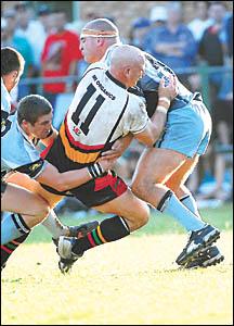 Coaches collide ? Craig Wallace is taken head on by John Cross.