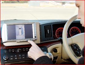 A driver operates controls on a panel screen.  PIC: KATSUMI KASAHARA